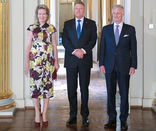 Queen Mathilde wore Erdem Finn dress bloomsbury yellow satin. Mr. Klaus Iohannis, President of Romania