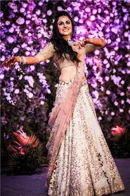 Beautiful Indian Bride In Ivory And Baby Pink Lehenga Choli.
