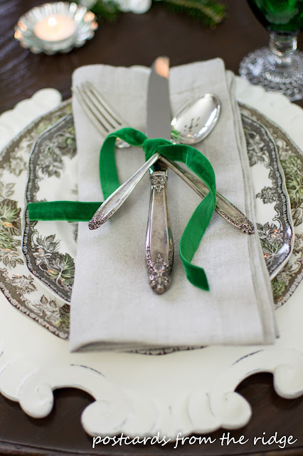 old silverware with green velvet ribbon Christmas place setting