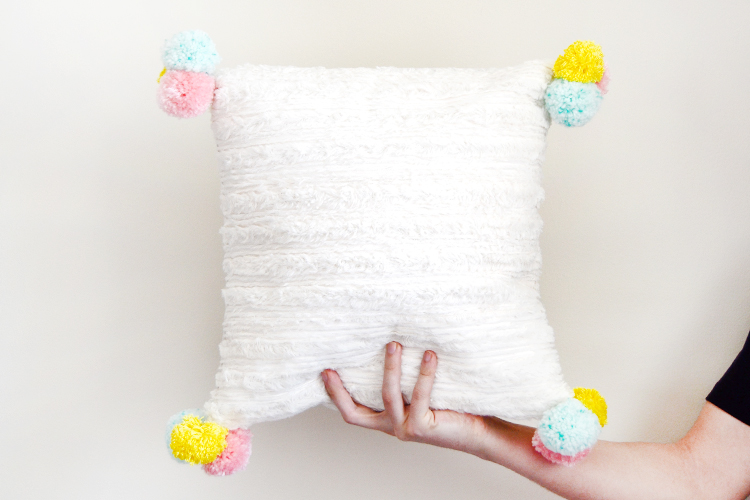DIY furry pillow with pom poms at Crafts Unleashed