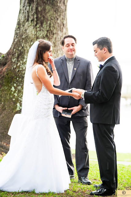 officiant talking to bride and groom
