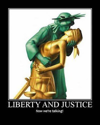 Statue of Libery kissing Lady Justice