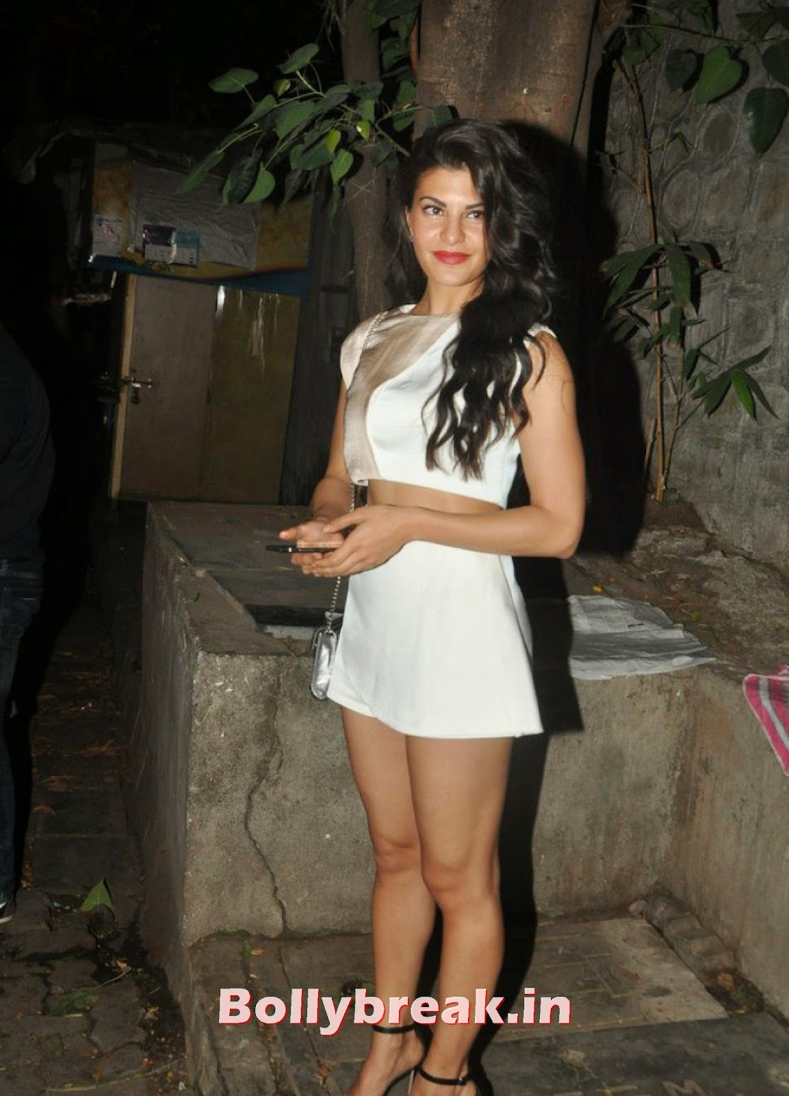Jacqueline Fernandez in white short dress, Hot Jacqueline Fernandez Snapped Outside Nido in White Dress