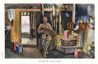 "Color frontispiece of sketch of ""Gus"" Masik in his cabin in Alaska. He is playing an accordian wearing hih boots with a big smile on his face. The cabin has a wood pile and a stove and Masik's modest belongng."