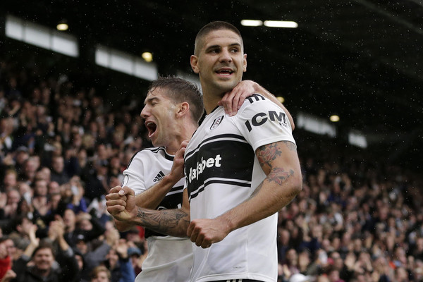 Aleksandar Mitrovic of Fulham celebrates with teammate Luciano Vietto after scoring his team's second goal during the Premier League match between Fulham FC and Burnley FC at Craven Cottage on August 26, 2018 in London, United Kingdom.