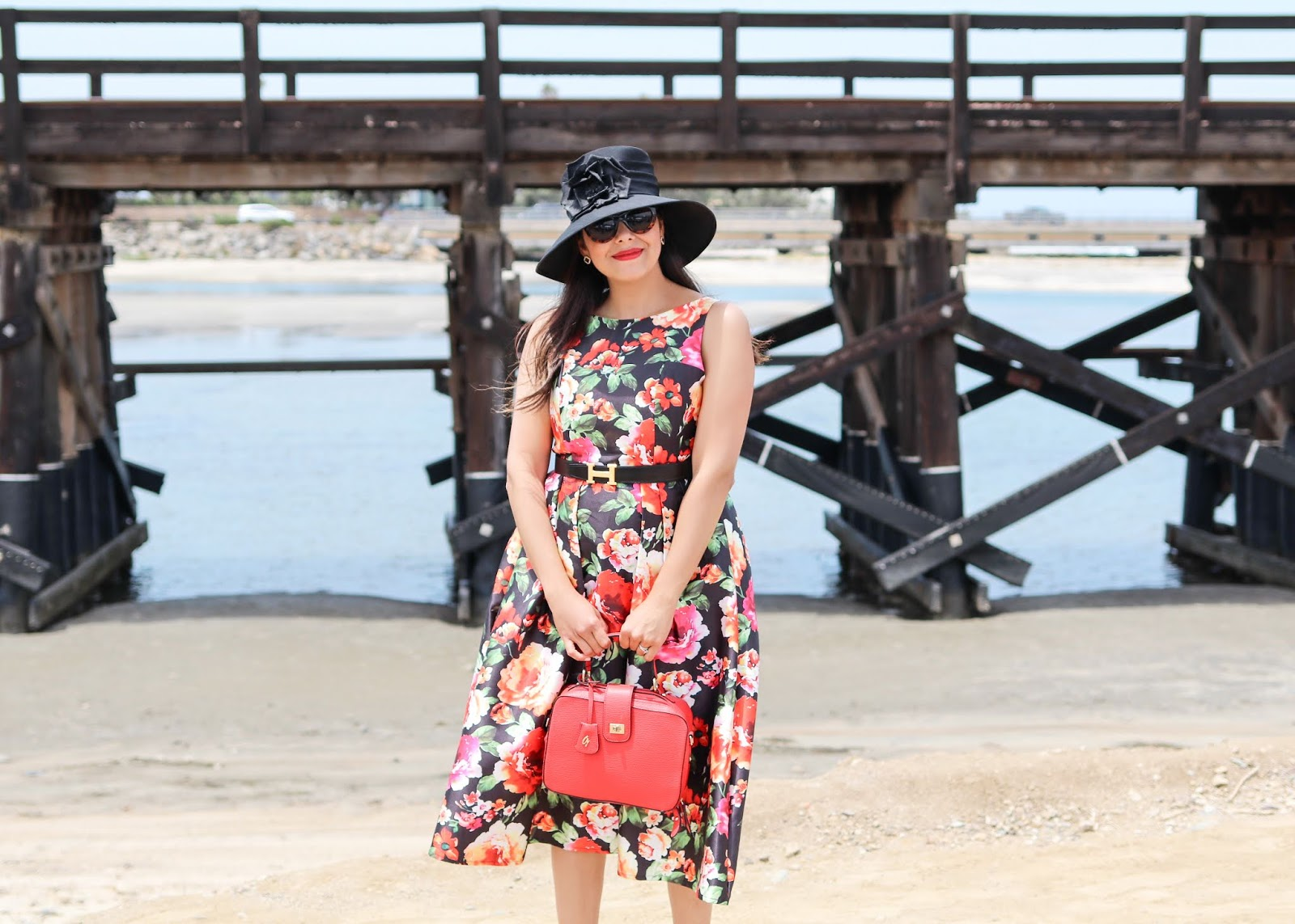 latina fashion blogger, glam outfit for opening day, big hat outfit
