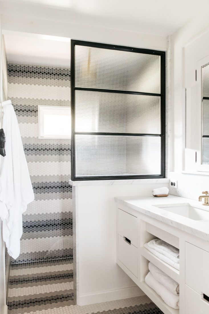 Modern ceramicstripe tile shower wall in beautiful oceanfront cottage on Maui - found on Hello Lovely Studio