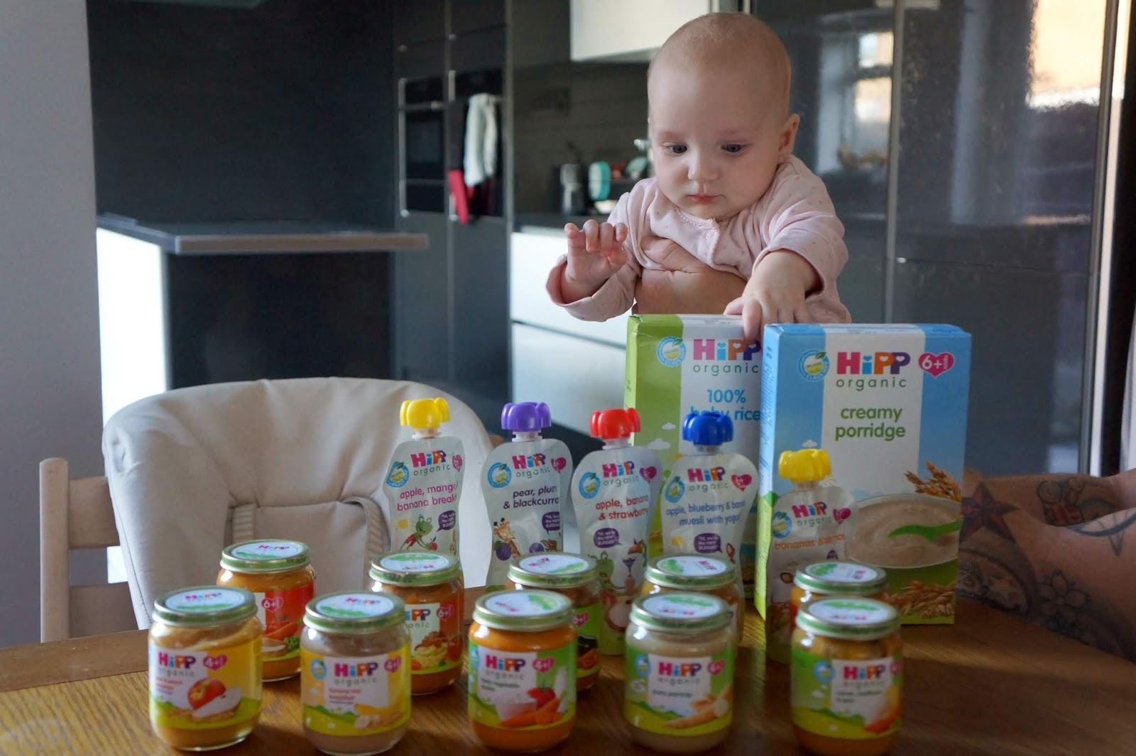 baby looking at weaning products