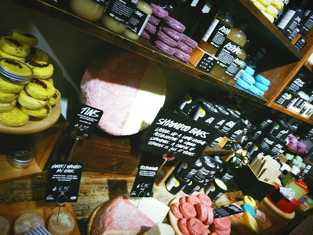 Various shampoos by Lush Cosmetics on a shelf