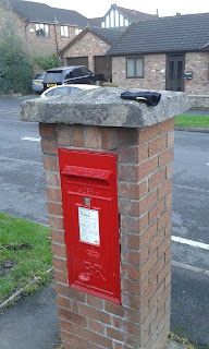 A post box AND a lost glove in Cheadle Hulme