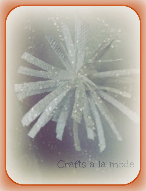 fake snowflake made with paper towel strips and glitter