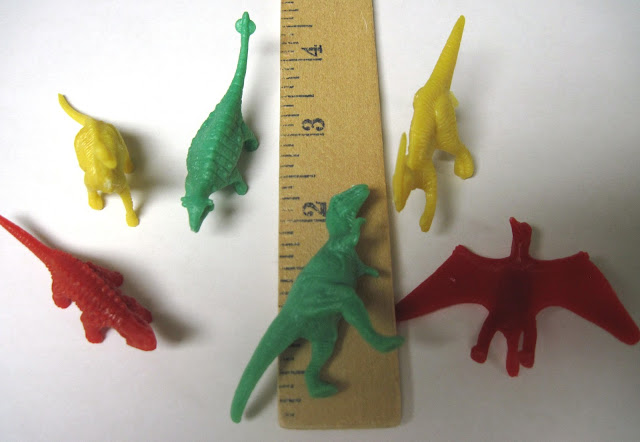 Plastic dinosaurs packed in Operation Christmas Child shoeboxes.