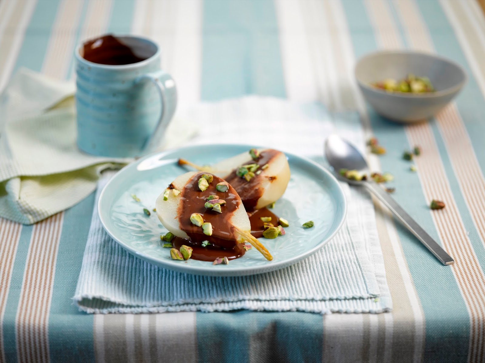 Poached Pears With Chocolate Sauce And Pistachios