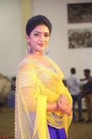 Actress Eesha in Yellow Choli Blue Ghagra at Darshakudu music launch 043.JPG