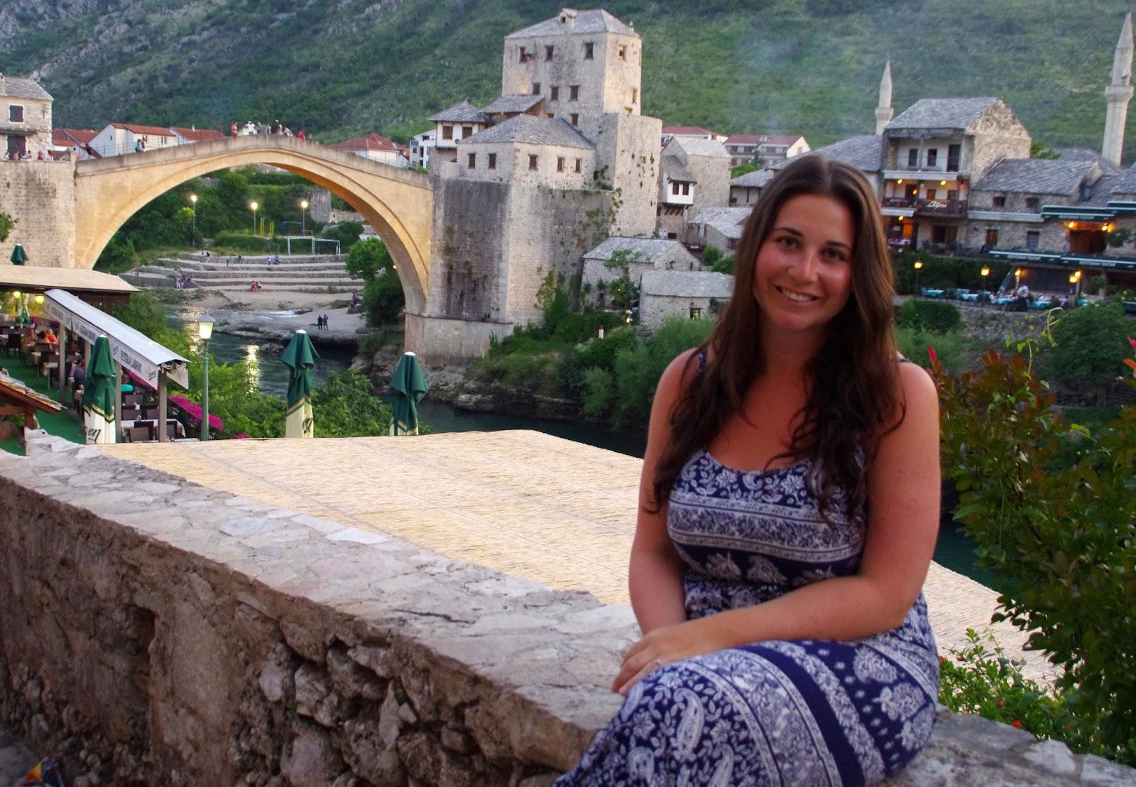 Girl sitting near Stari Most Mostar