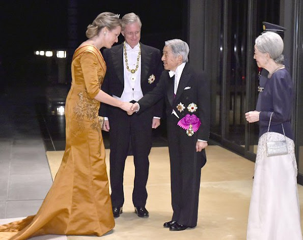 Queen Mathilde diamond tiarra, wore gown, jewellry diamond earrings satin dress gold handbag