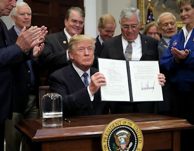 President Trump signs order directing NASA to send Americans back to the Moon and Mars.