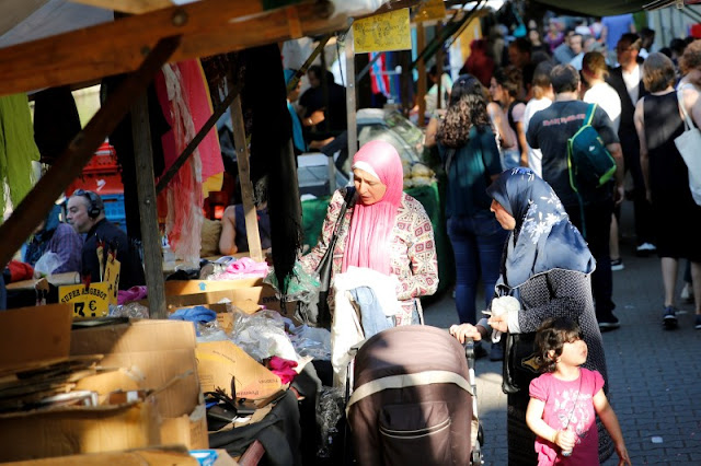 Image Attribute:  People visit a market in Berlin's Kreuzberg district, Germany, August 19, 2016. Picture taken August 19, 2016. REUTERS/Axel Schmidt