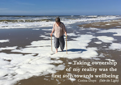 photo of Corina Duyn walking on the beach with walking sticks, feet in water. with quote: Taking ownwership of my reality was the first step towards my wellbeing.