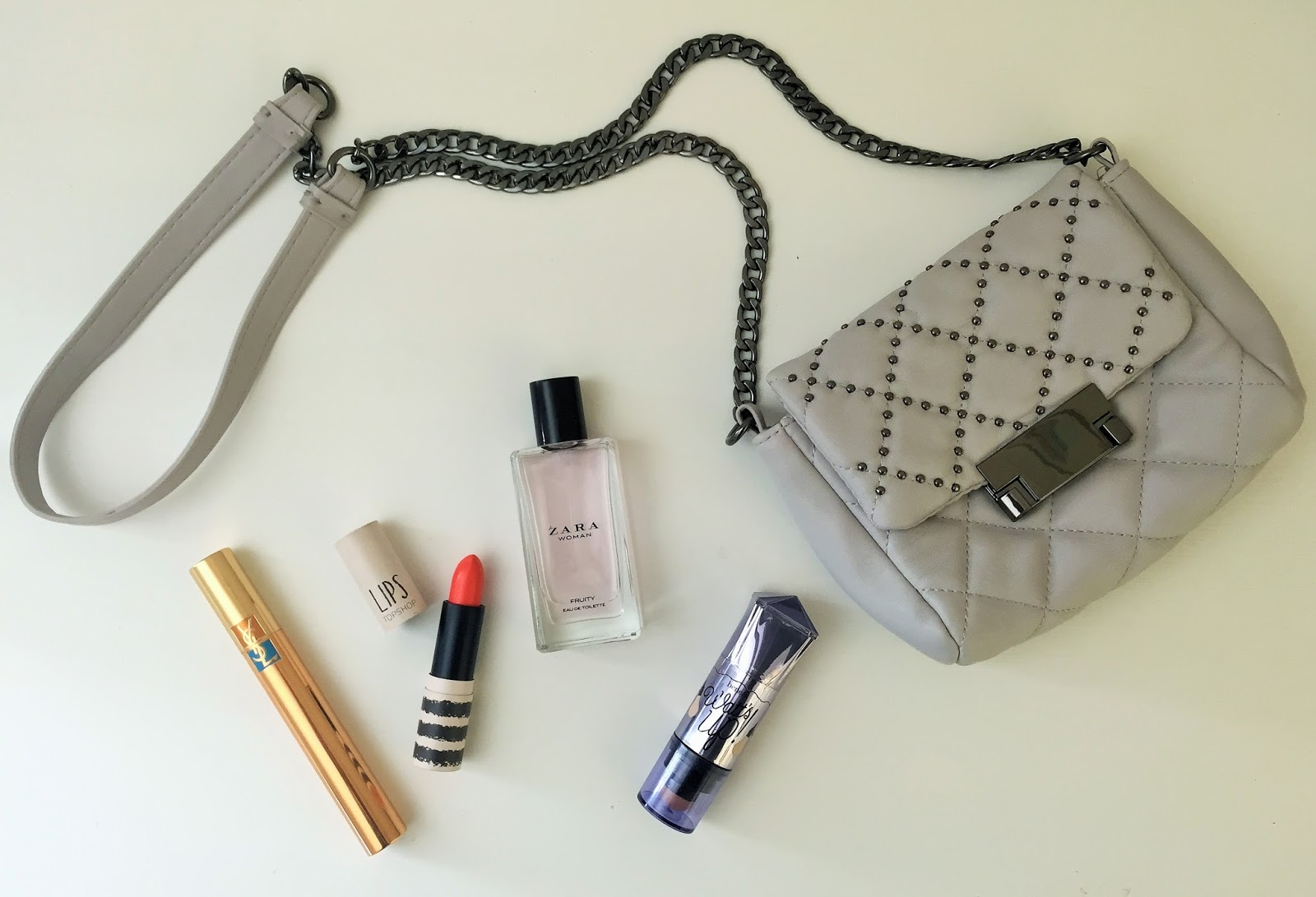 "Holiday Heroes featuring YSL mascara, Topshop lipstick in Charmed, Zara ""Fruity"" Eau de Toilette, Benefit Watt's Up and Topshop Bag"