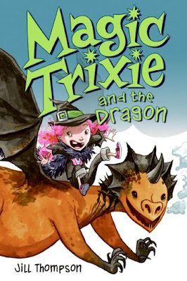 cover of 'Magic Trixie and the Dragon' showing a girl in traditional witches garb with pointy hat riding a smiling dragon