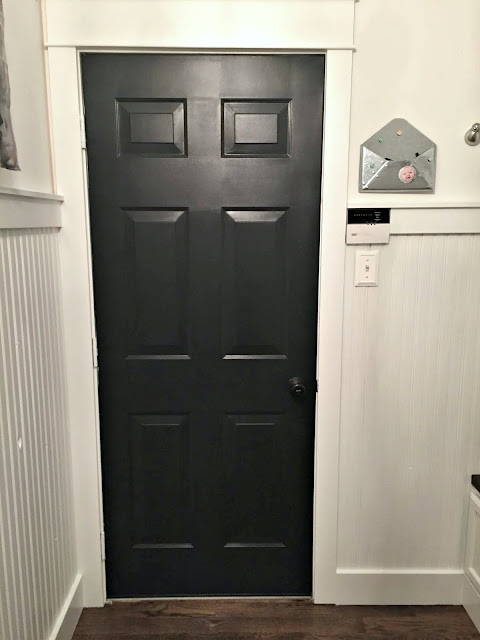 black door white walls