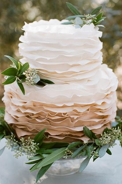 ruffled wedding cake with eucalyptus