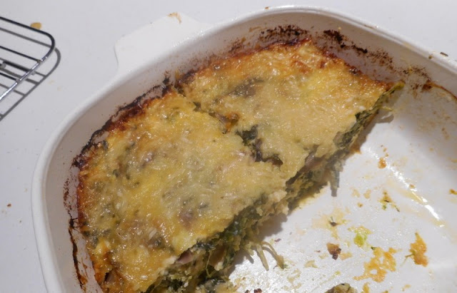My Low-Carb Spinach Pie in a Casserole Dish, Half Eaten