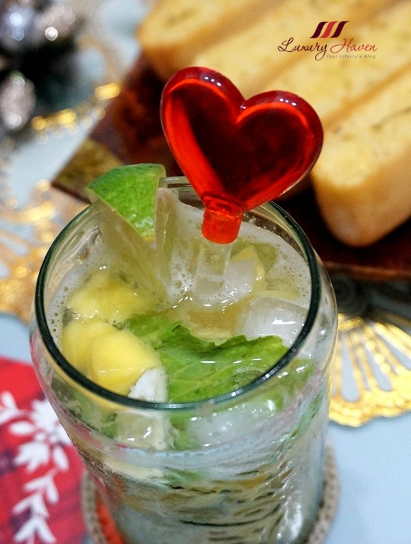 heart shaped stirrer non alcoholic bubbly mango spritzer