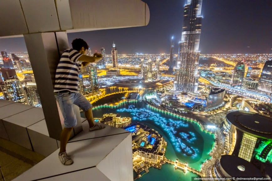 8. Urban Climbing in Dubai (same crazy guys as above) – Dubai, UAE - 27 Amazing Travel Photos That Will Infect You With The Travel Bug