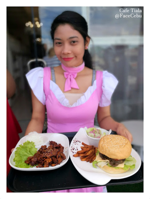The waitress serving them burgers and fries from Cafe Tiala