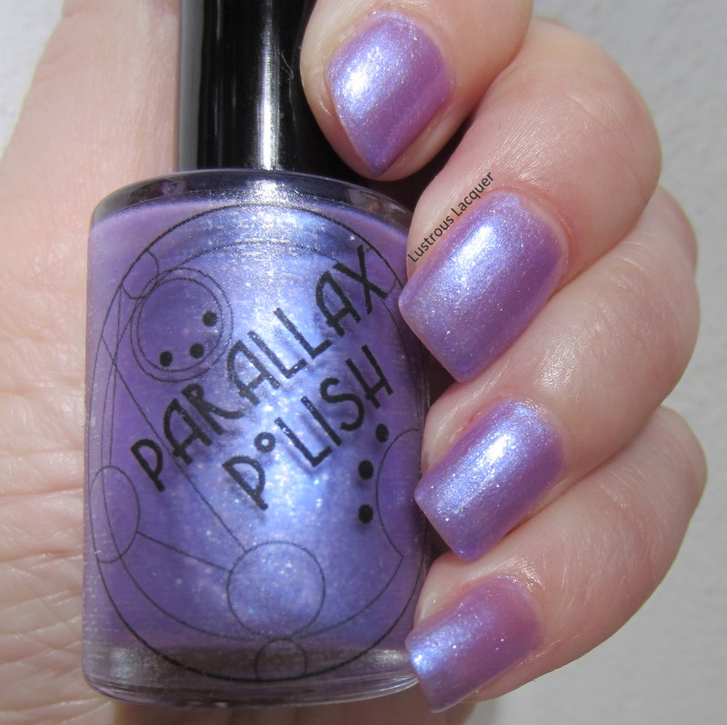Sheer-purple-nail=polish-with-silver-flakies