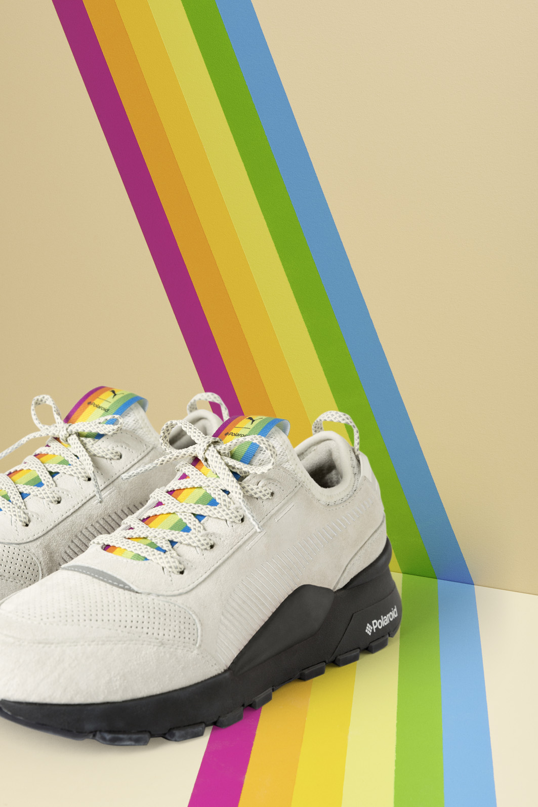 98f7ae0a0b4 The RS-100 Polaroid sneaker reimagines the 80 s RS-100 model with hints of  photography elements. Between the two sneaker styles