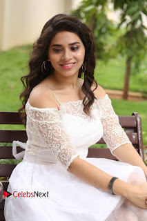 Actress Tejaswini Pictures in White Dress at Lachhi Teaser Launch  0130.JPG