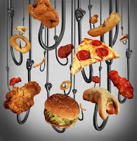 Fatty foods hanging from hooks