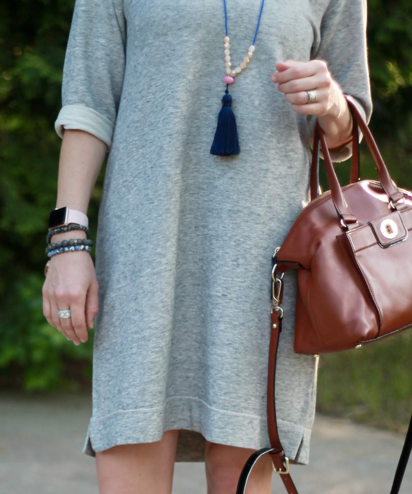grey sweatshirt dress, blue loafers, Kate Spade cognac satchel, tassel necklace