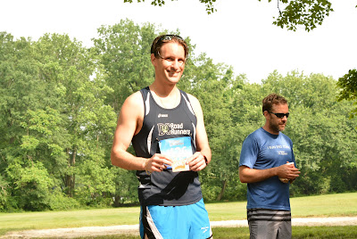 Joseph P Fisher winning a gift card at the DC Road Runners Run after the Women 5K