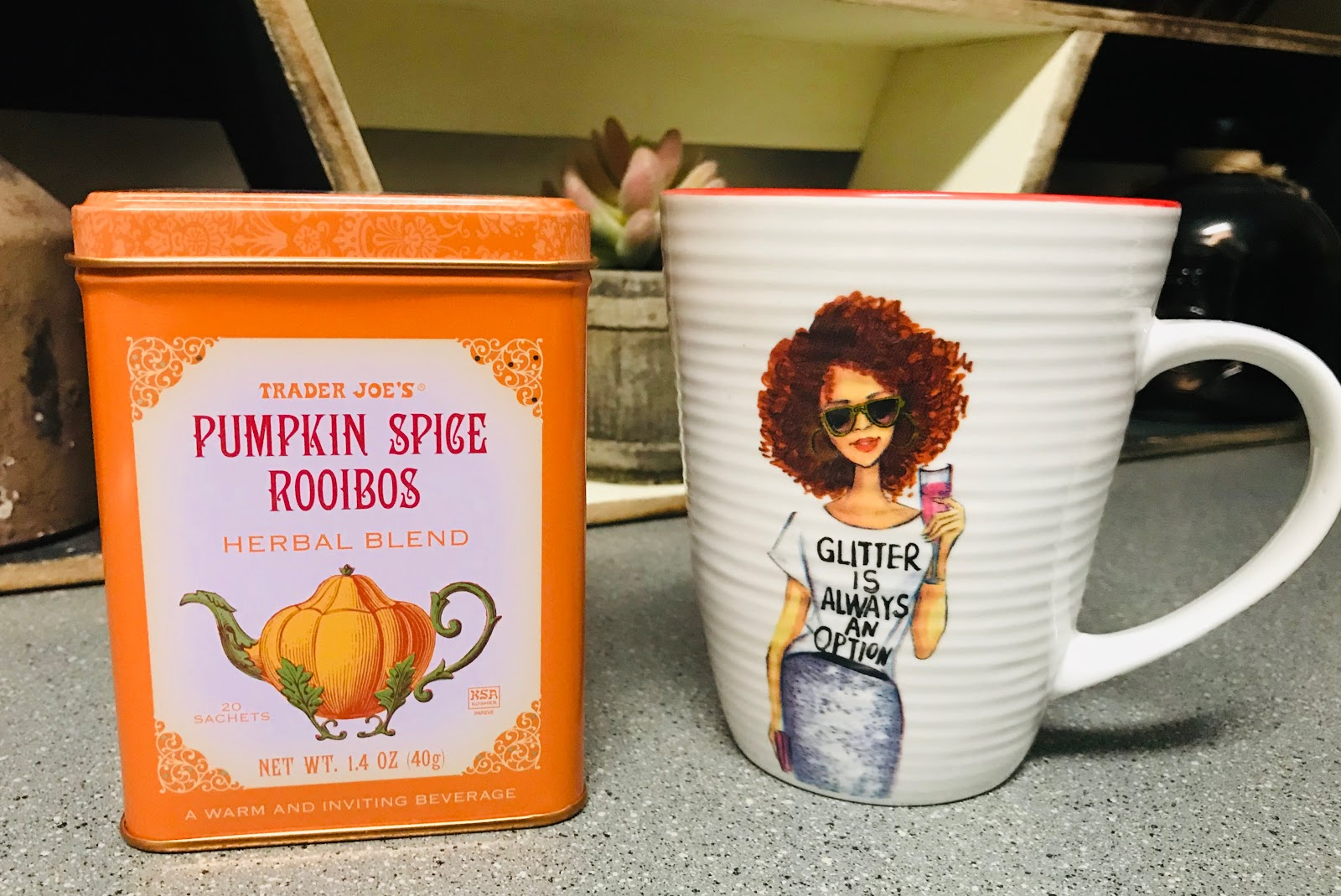 Image:Pumkin Tea from Trader Joe's, Coffee Cup From TJMAX. Woman Shares her weekend bits and favorites.   Trader Joe's was my first hit to grab a few things I needed for my household, I couldn't resist grabbing The Pumpkin Spice Roibus Tea. I am not making this up, but hands down the aroma when steeping is the best. I love the way it scents up the kitchen as the steam comes from the cup. DId someone say cup? Yes, I have a fetish with cute coffee/tea cups. But, I am trying to resist the urge to buy a dozen fall cups. I did grab the cutest little (Glitter is always optional) one. It was calling my name, so for $3.99 at TJMAX I felt it was worth the splurge. Oh and I thought the girl on the cup looked like a woman boss.