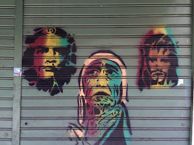 Palermo street art: 3 rasta faces