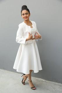 Rakul Preet Singh Stills in White Stylish Dress at International Phenomenon Sensation Press Meet  0036.jpg