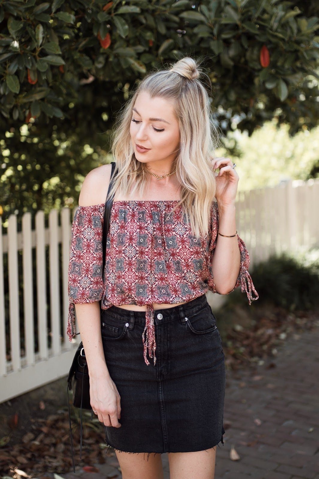 black denim mini skirt with an off-the-shoulder top