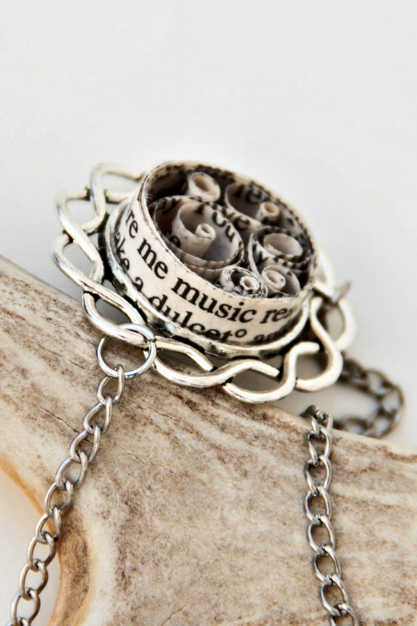 quilled book text on silvertone bezel and necklace chain