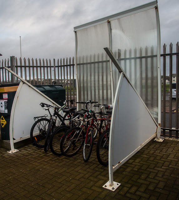 Photo of the roof blown off the marina bike shed