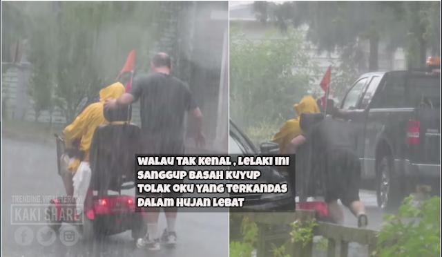 OKU terperangkap bersama kerusi roda dalam hujan lebat, lelaki budiman yang tidak dikenali sanggup basah berhujan menolaknya, terharu!