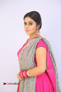 Actress Poorna Pictures in Red Salwar Kameez at Jayammu Nischayammu Raa Teaser Launch  0007