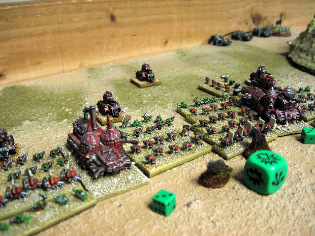 berzerkmonkey's Orks give a Braveheart-esque salute to the Giant Green Cube.