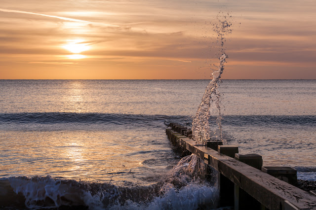 Water movement captured at sunrise in a big splash on Swanage beach