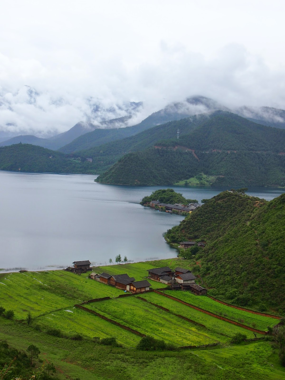 Lugu Lake with clouds covering the mountains