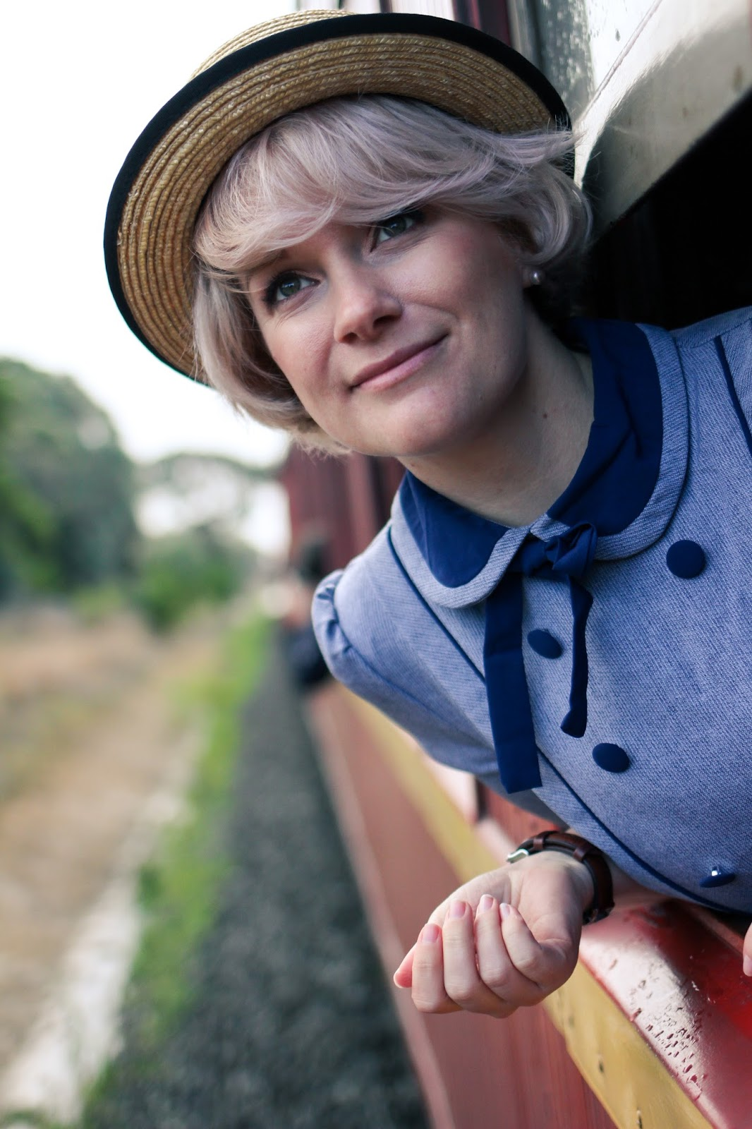 Liana of Finding Femme wearing Daniel Wellington watch, Sheinside peter pan collar dress, straw boater hat and Modcloth wedges for Ballarat Heritage Weekend on the steam train.