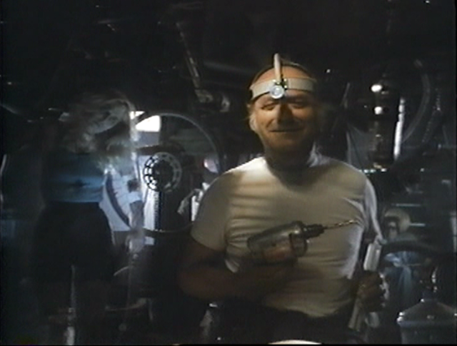 Jake (Danny Nelson) preaches and performs experimental surgery in BLOOD SALVAGE (1989).